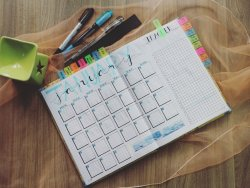 photo-of-planner-and-writing-materials-760710